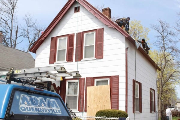 This is a photo of a local roofing construction project, home with white siding.