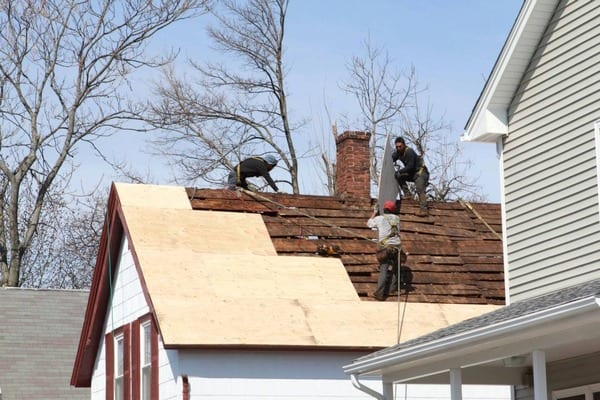 This is a photo of a local roofing replacement project with the plywood being laid down.