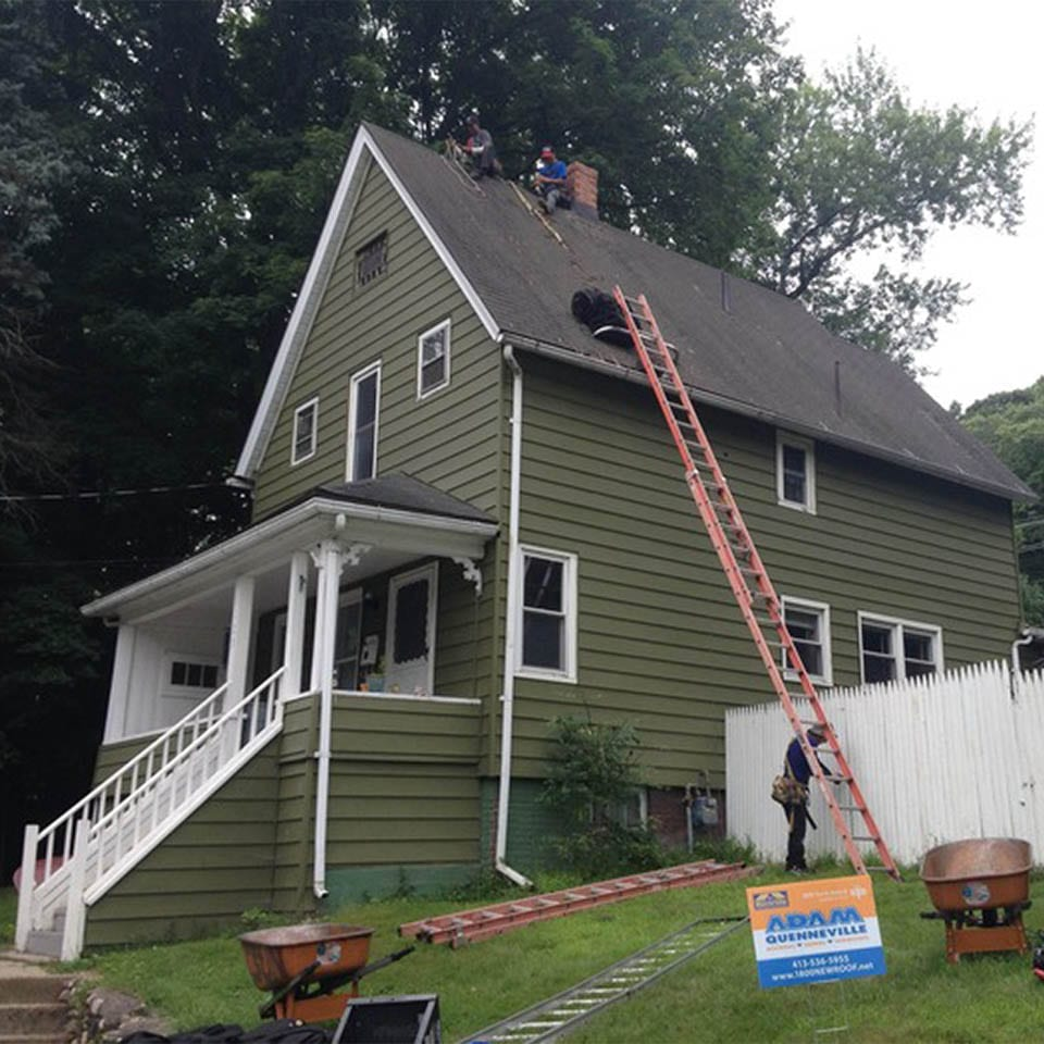 This is an before photo of a roof replacement project in Holyoke, MA