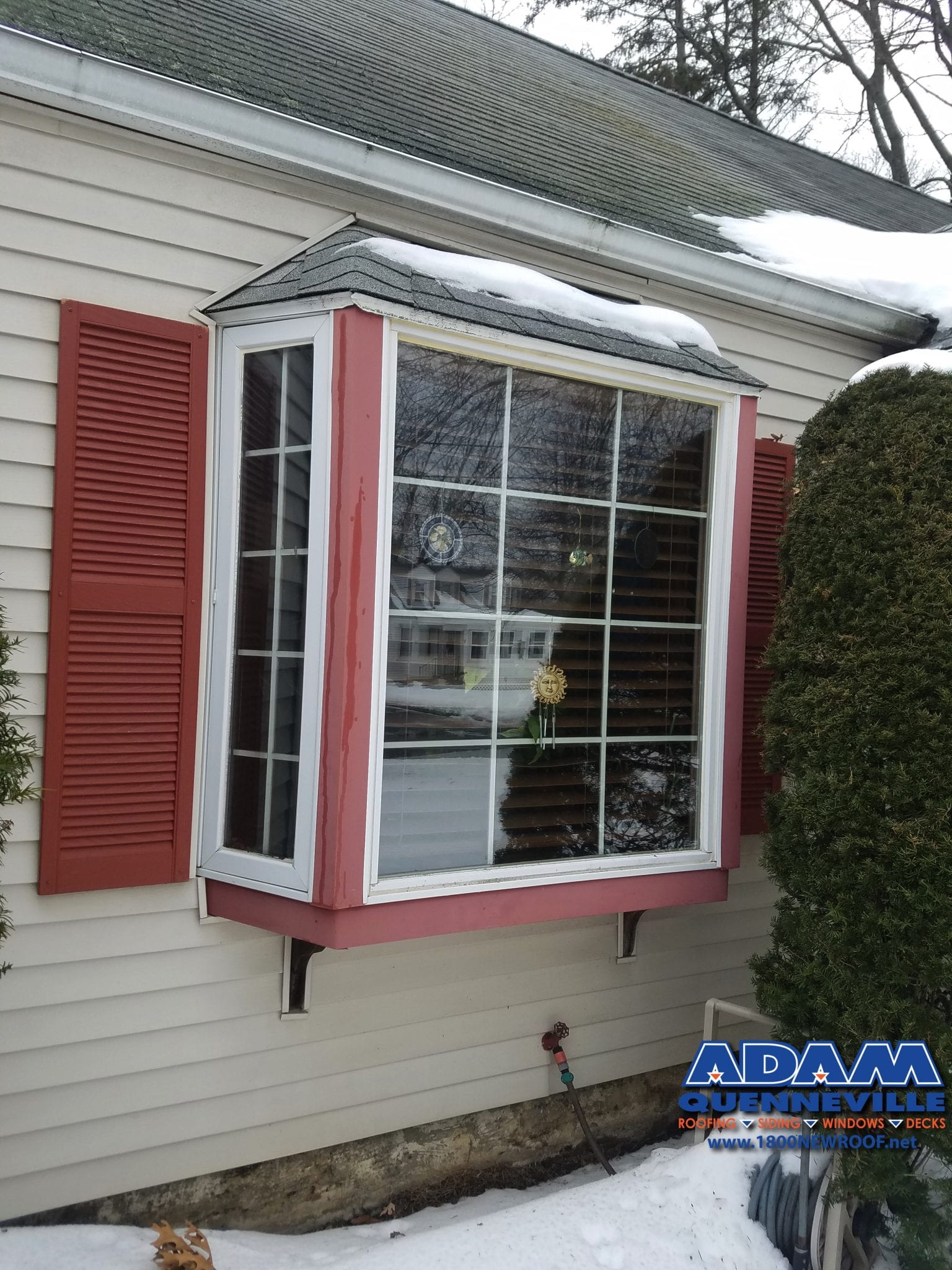 This is a photo of a completed siding replacement project with beige siding.