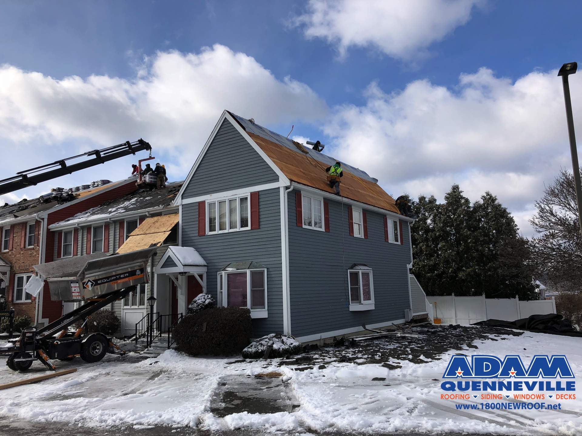 This is a photo of a local roofing and siding replacement project with most of the hold shingles removed.