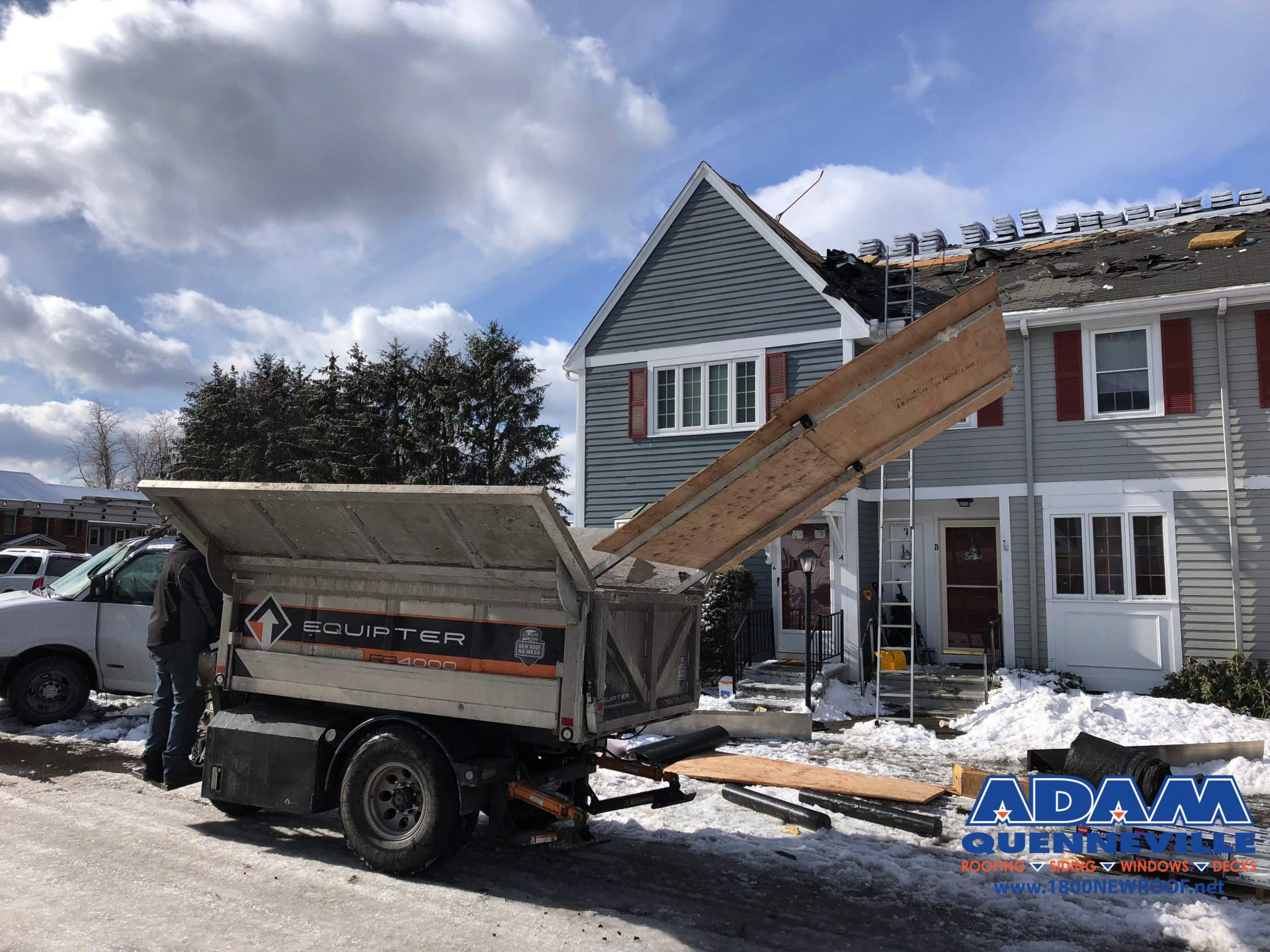 This is a photo of a local roofing and siding replacement project in progress with most of the old shingles removed.