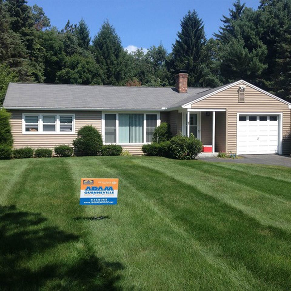 This is a photo of a home with new vinyl siding.