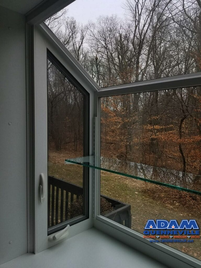 This is a photo of a local window replacement project overlooking the back yard.