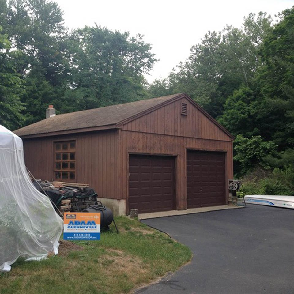 This is a photo of a roof replacement on a brown garage, before photo in Westfield, MA