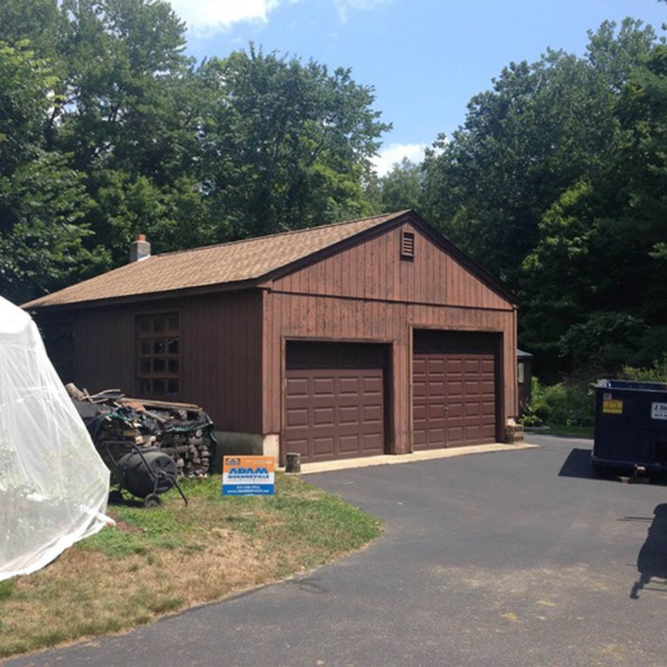 This is a photo of a roof replacement on a brown garage, after photo.