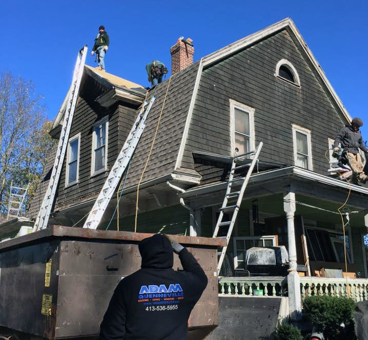 roof being repaired by Adam Quenneville Roofing crew